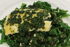 almond coated cod with lime and coriander on bed of kale